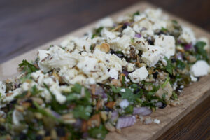 mediterranean salad with feta featuring mckenzies superblend mix with lentils, quinoa and beans