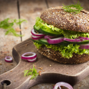 a simple and delicious veggie quinoa burger served with whole grain rolls and salad from mckenzies foods